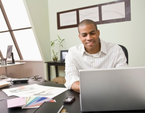man at computer in office